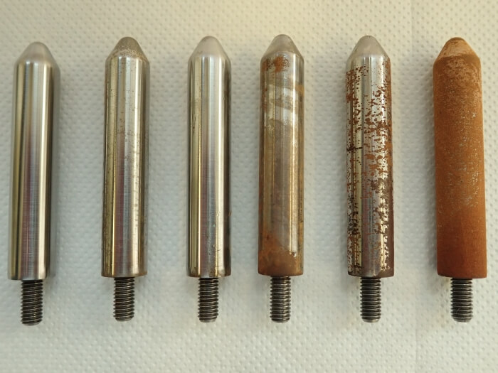 Different stages of steel corrosion after test setups
