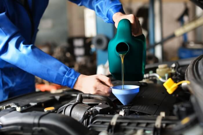 Refilling a car engine with motor oil