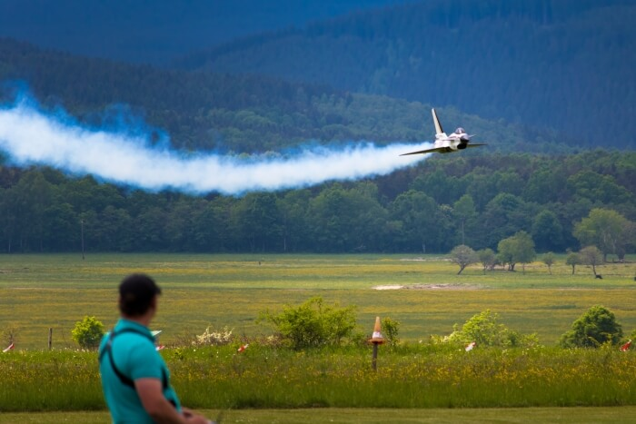 Model aircraft with smoke from white oil