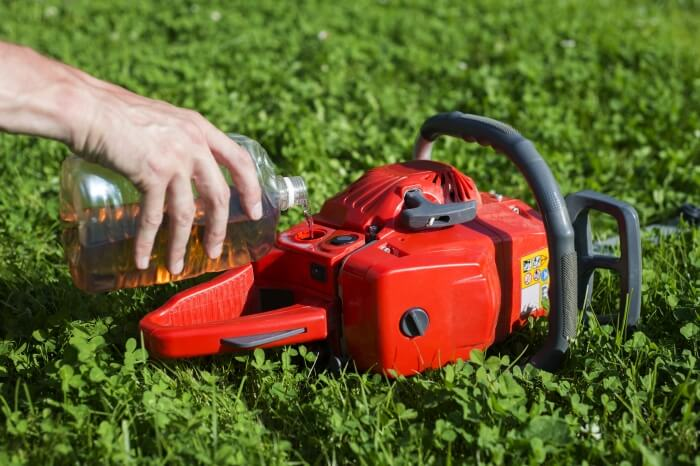 Top up chain saw oil