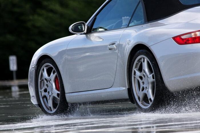 Porsche on a wet street